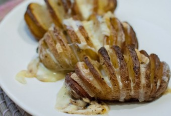 Baked Hasselback potatoes with raclette cheese
